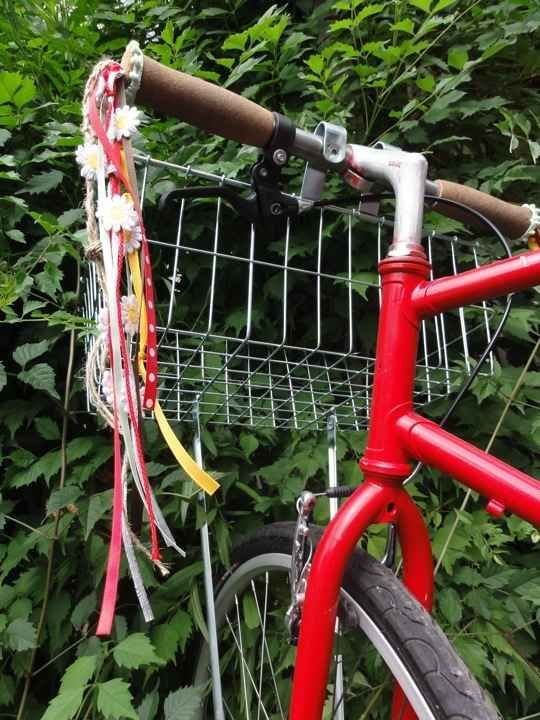 a girls bike with funky streamers on handle bars