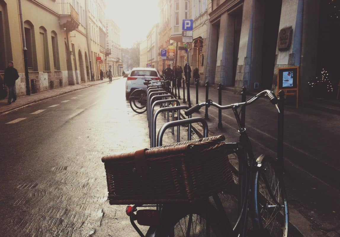 bike with basket and street in sunlight in the background