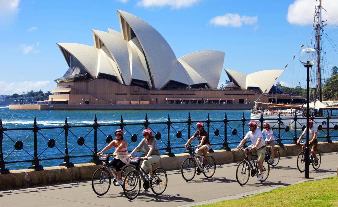 bike riding alongside Sydney Opera House